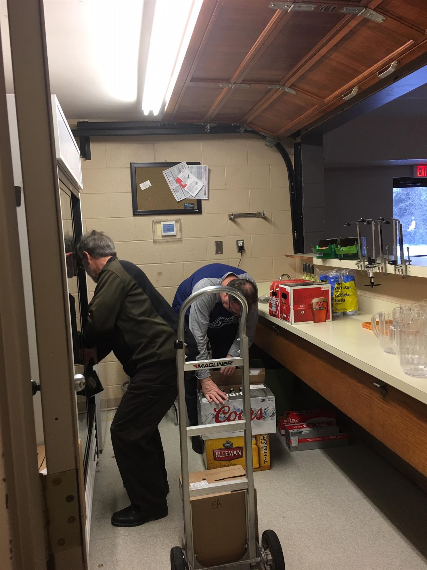 Loading up the bar fridge