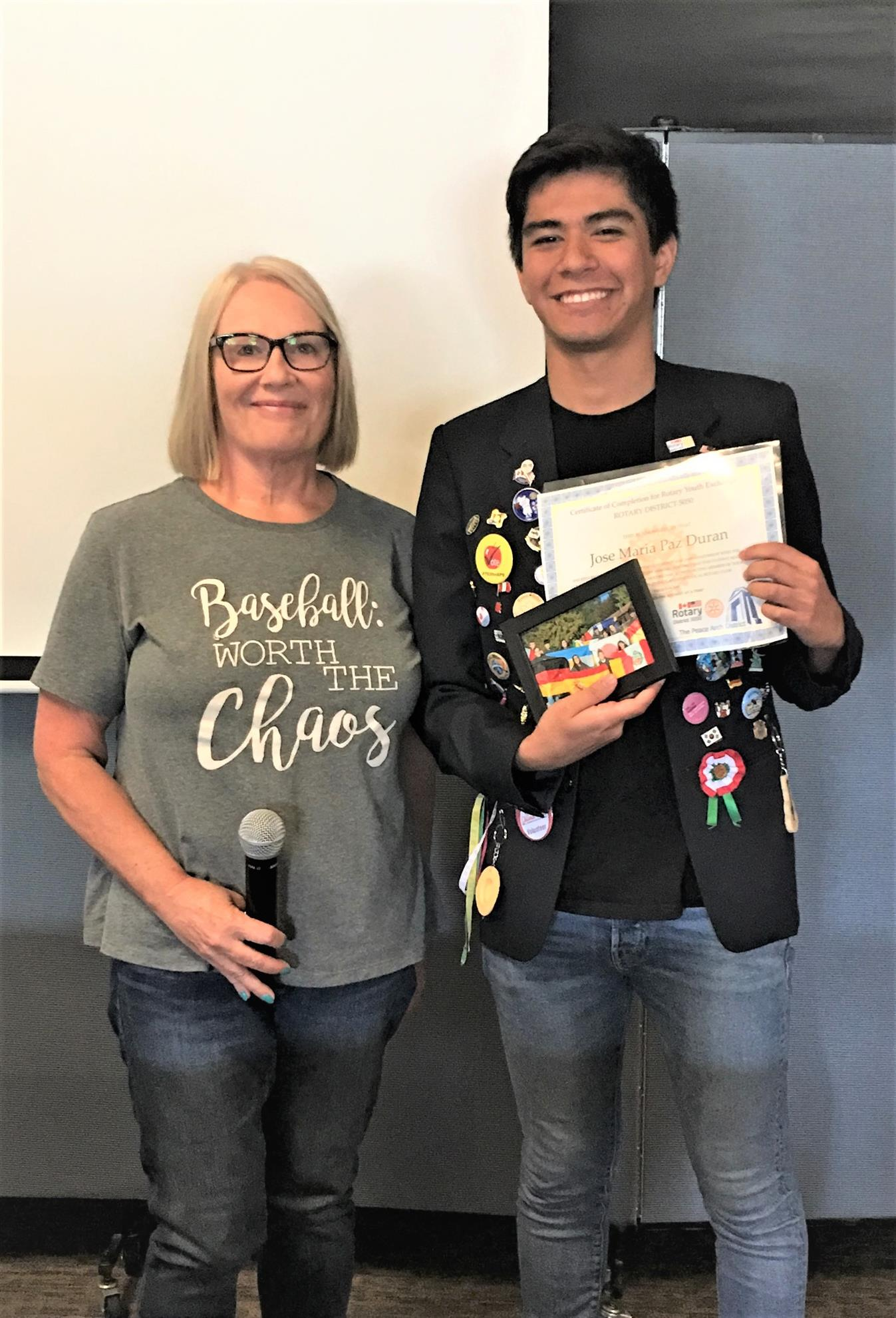 7187c7de ... a Duck Dash t-shirt, and an Arlington hoodie. Our Rotary Youth Exchange  Officer, Sue Weiss, also presented him a certificate and a framed photo of  ...