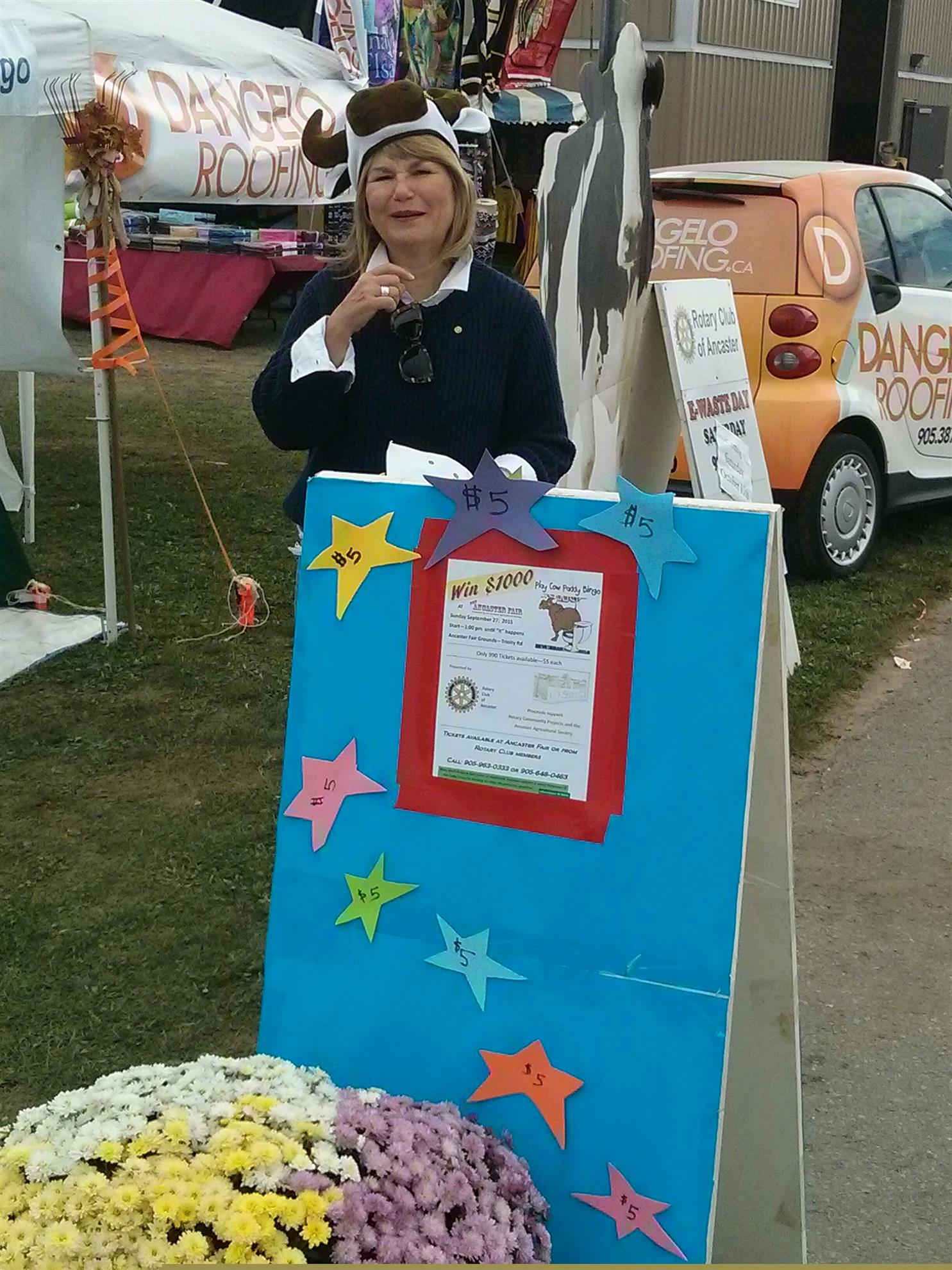 Kathy at Cow Paddy Bingo booth selling tickets