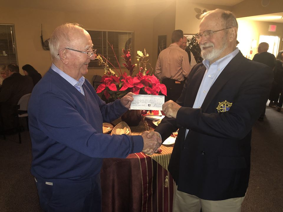 Rotary Club of Hamilton East-Wentworth secretary Jim McDonnell presenting $14,000 cheque to Jim Casey, Burlington Able Sail, for new coach boat.