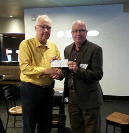 John Baxter presents cheque to Dough Farraway