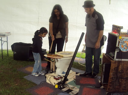 Exploring an unusual musical instrument at Imagine in the Park