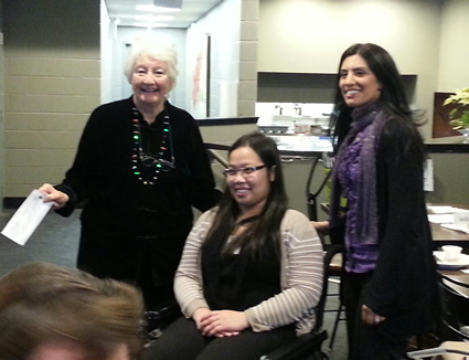 Laurel Thompson and Helen Dam accept cheque from past president Shikha Sareen