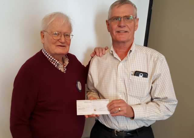 President Hadley Jackson presenting a cheque to Al Martens of the Simcoe Caring Cupboard