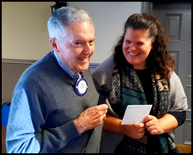 President-Elect Ron Baker thanking Leah Logan of Indwell
