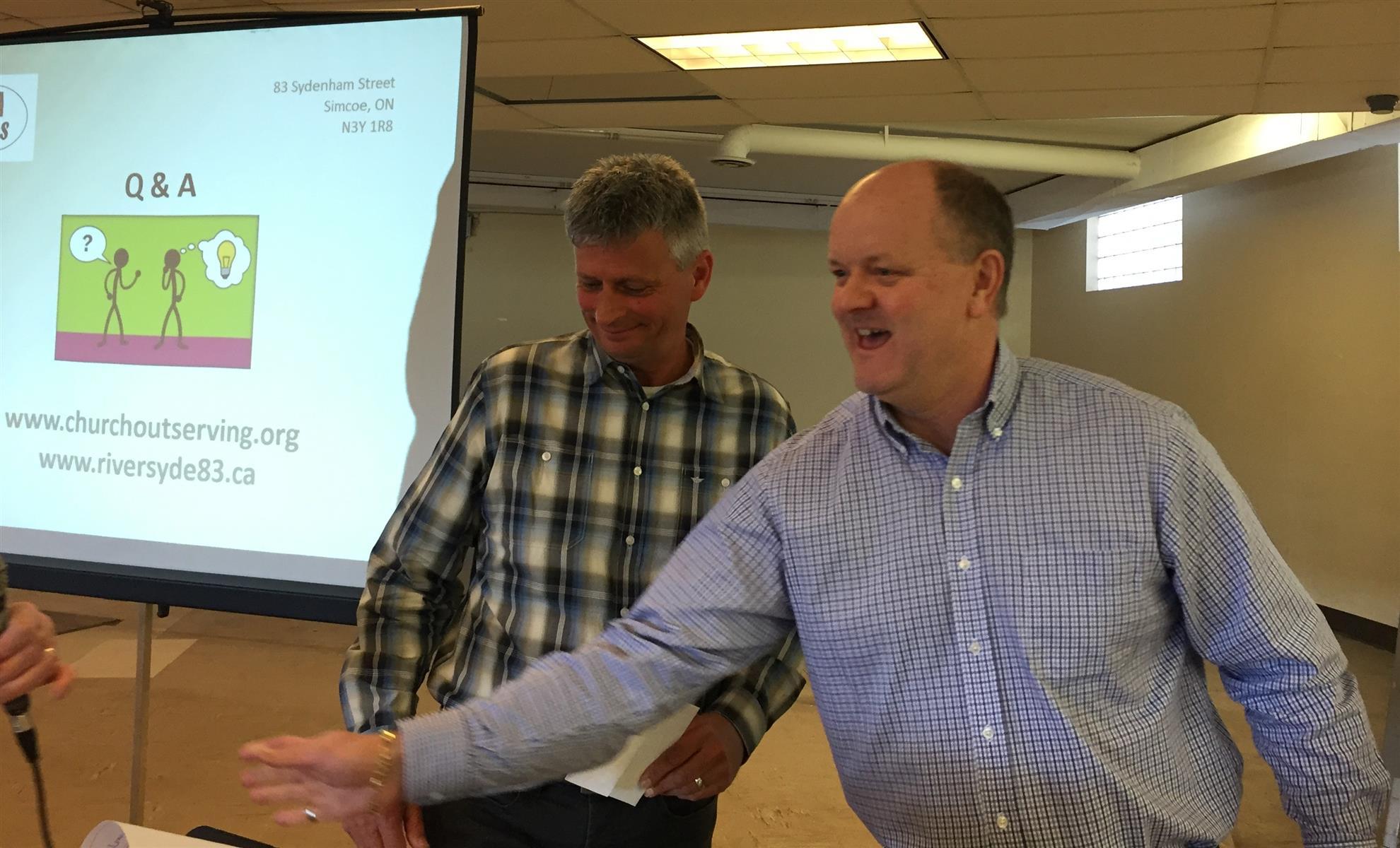 Rotarian John Valle thanks Eric Haverkamp, Board Chair of
