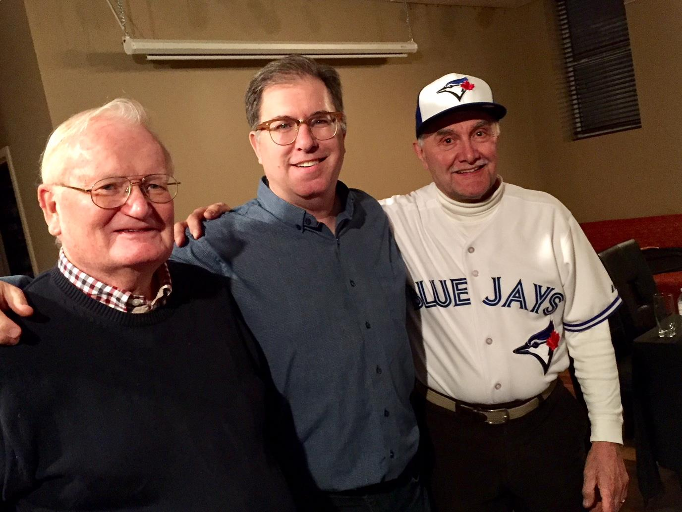 Simcoe Rotary Club President Hadley Jackson, Blue Jays announcer Mike Wilner and fan Dennis Craddick.