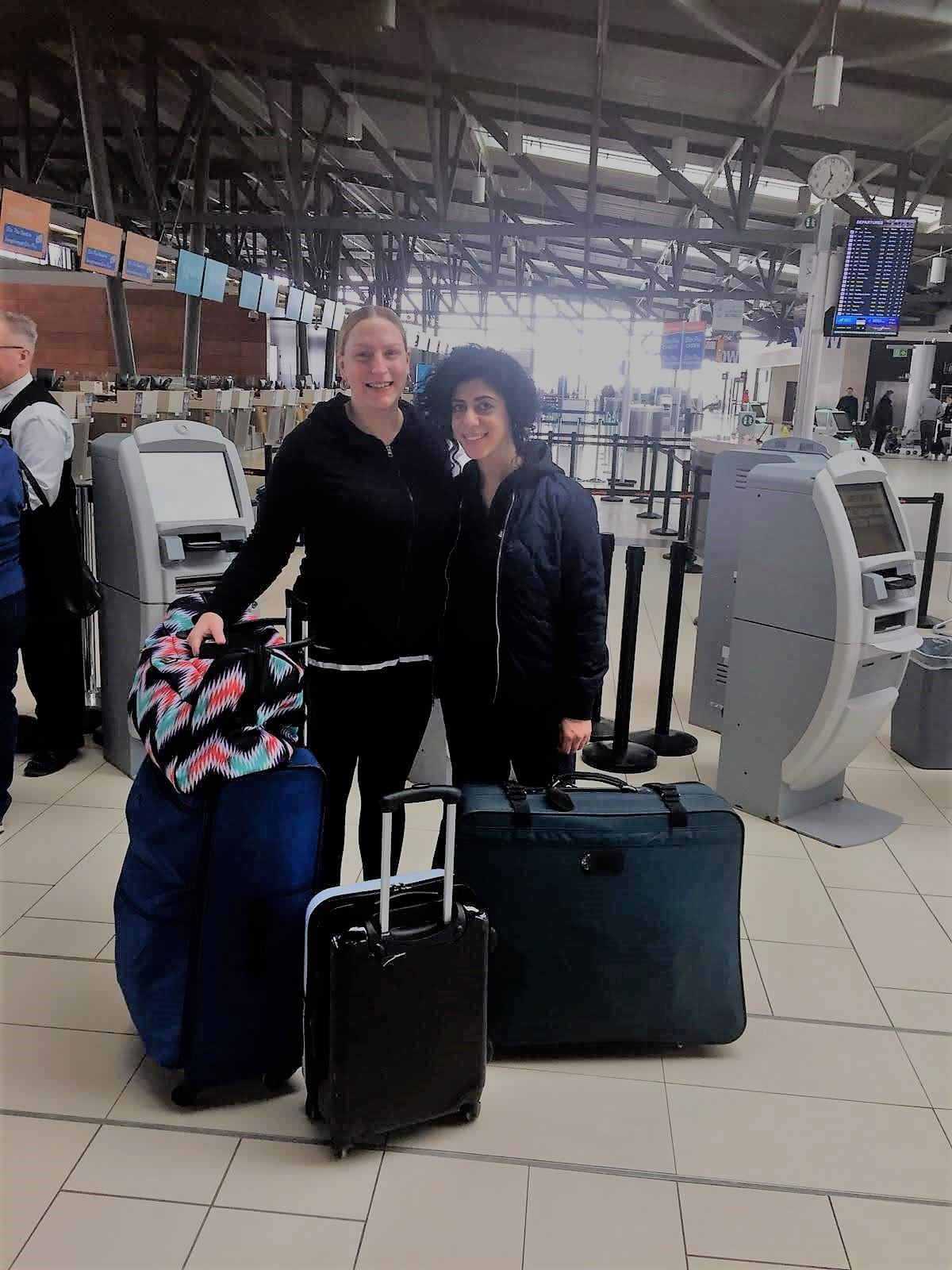 Volunteers Leanne and Nadine take the bag of shoes on their flight to Kenya