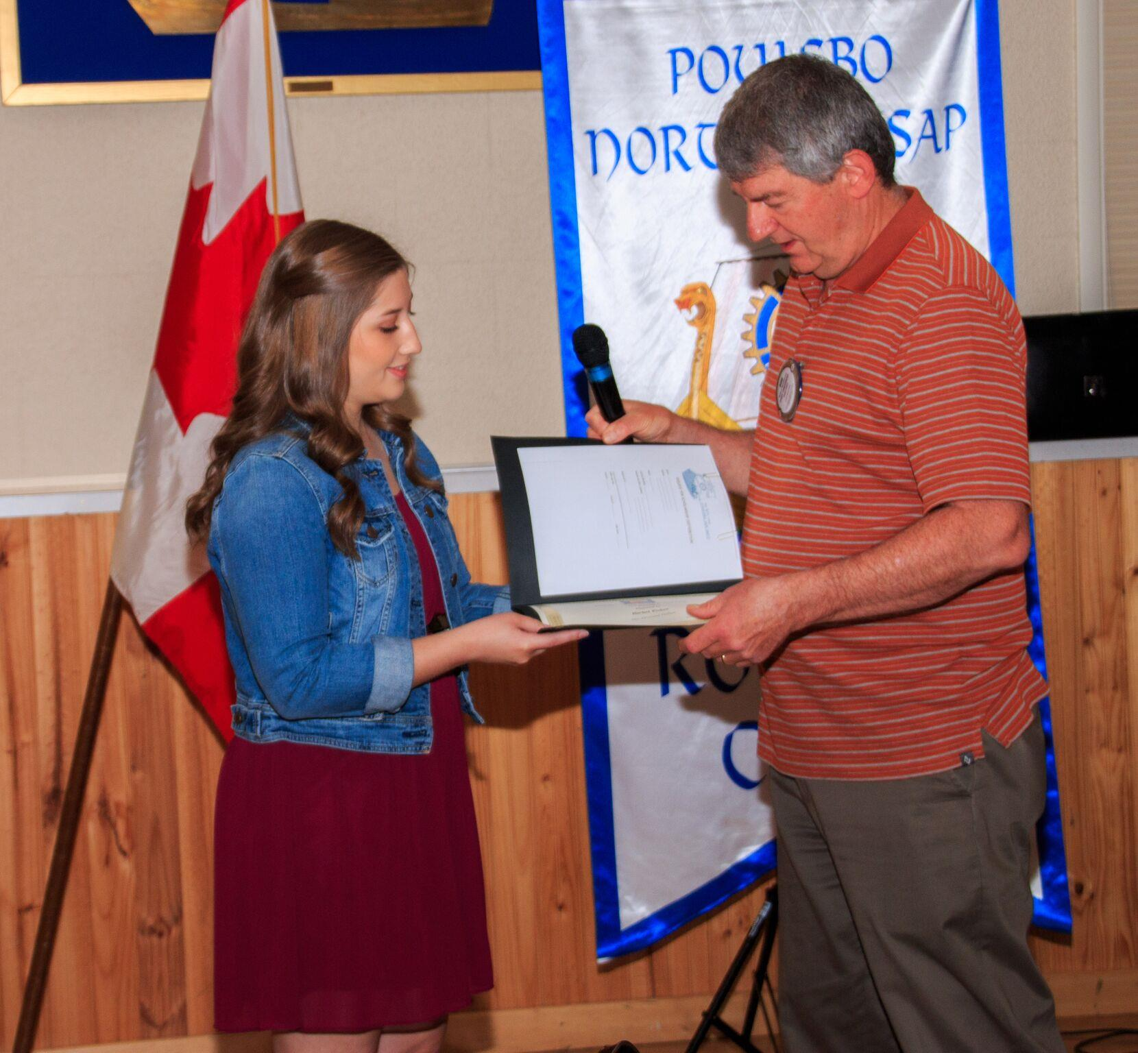 Bob Hawkinson presents scholarship check to Rachel Fisher