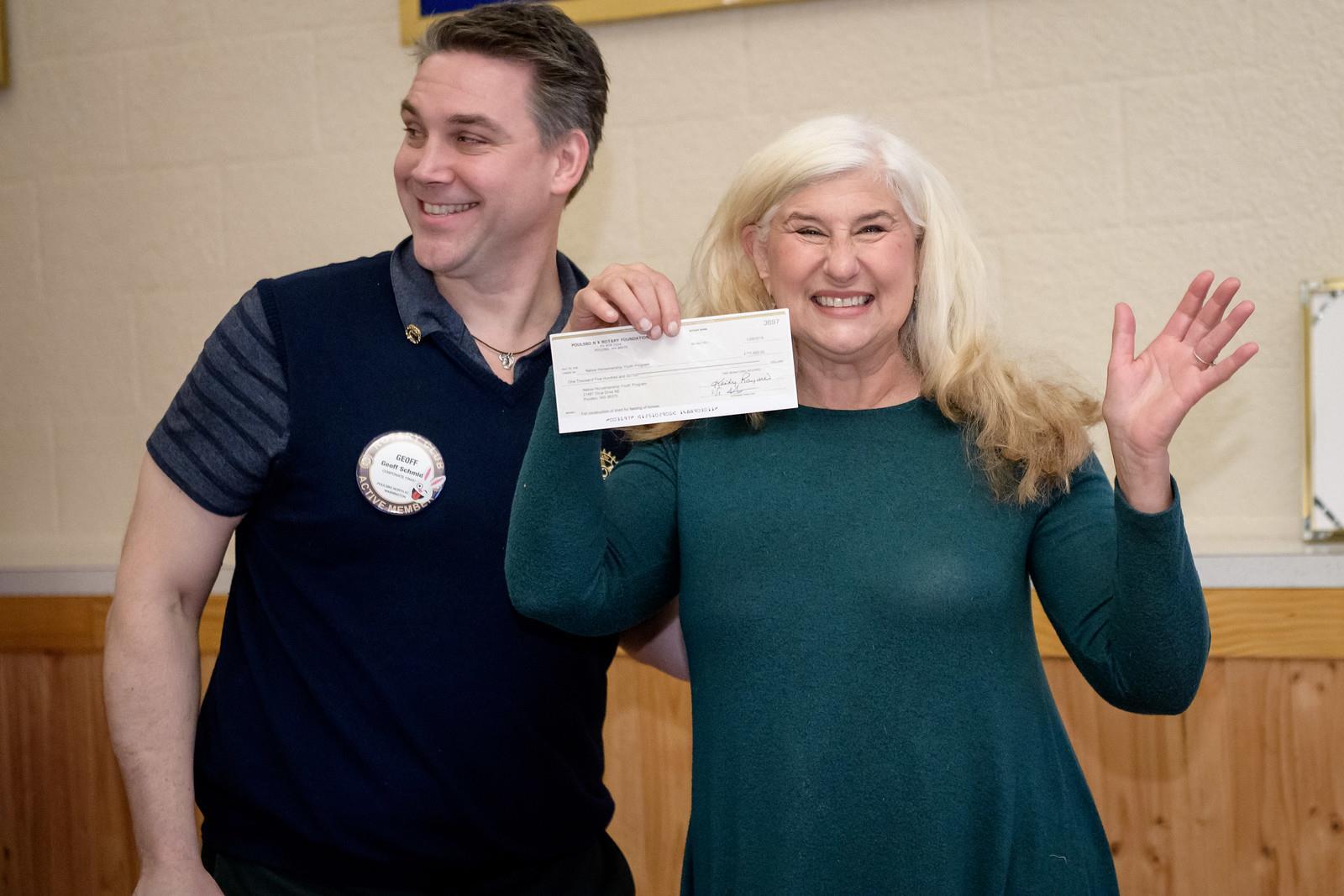 Geoff Schmidt presented a check to Lee Ferguson of the Native American  Horsemanship Youth program 57cbdc0bc87