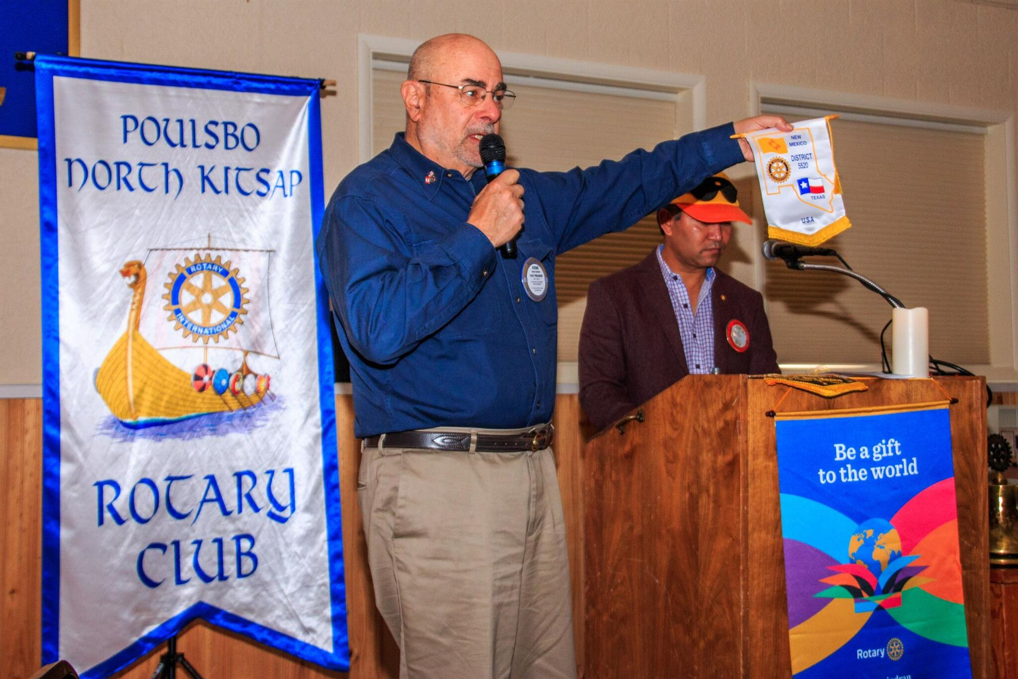Steve Garfein presents flags from six sister clubs
