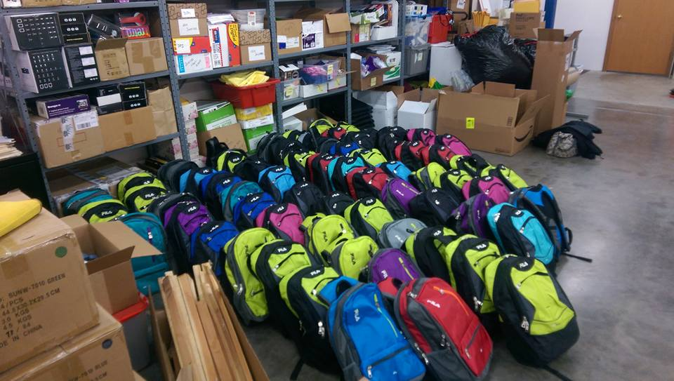 04c8489579a5 Midday Rotary and families assembling 100 backpacks for Middle School  students of families with need in the Gig Harbor area. Good job