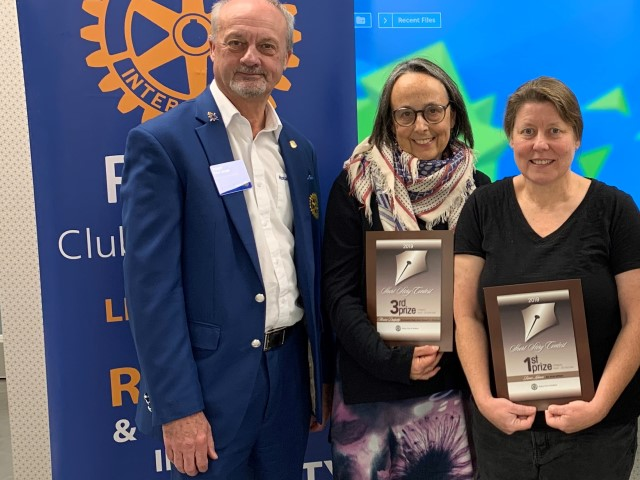 Rotary District 6330 Governor Tony Sheard with prize-winning authors Alexina Dalgetty and  Renee Lehnen