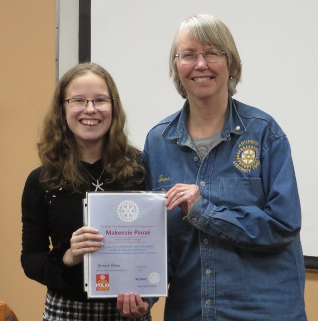 Mackenzie Pauze receiving PolioPlus Donation Certificate