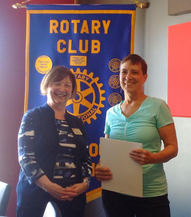 President Joan Hunter welcomes Jeanine Parker to the Rotary Club of Ottawa South.