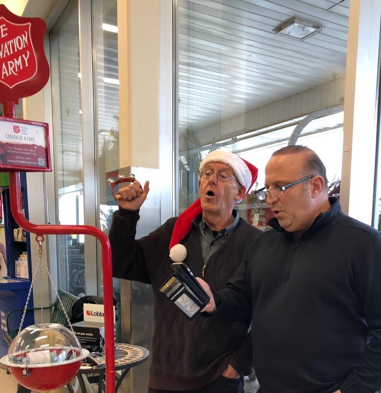 Rotary Club of Ottawa South members Alex Davidson and Luigi Maiorino belt out Christmas carols while collecting funds for the Salvation Army Christmas Kettle.