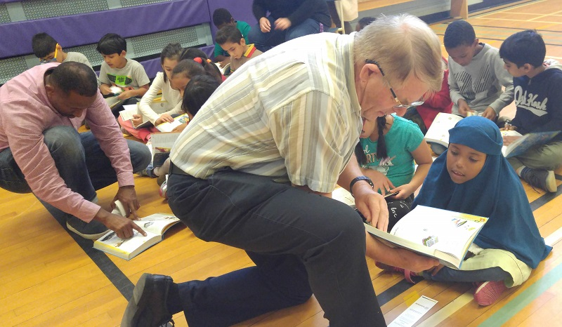 Rotary Club of Ottawa South distributing dictionaries at Charles H. Hulse school.
