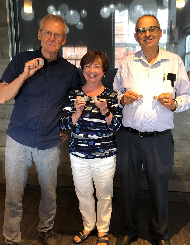 Rotary Club of Ottawa South exec members Alex, Joan and Sam receive their pins.