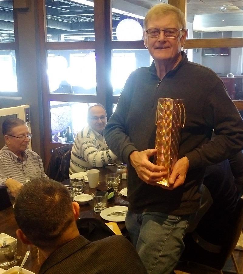 Rotary Club of Ottawa South give a retirement gift to Bernie Ingimundson