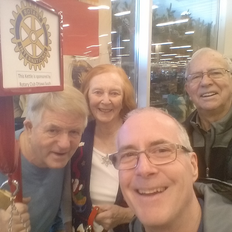 Rotary Club of Ottawa South members volunteer for the Salvation Army Christmas Kettle campaign.
