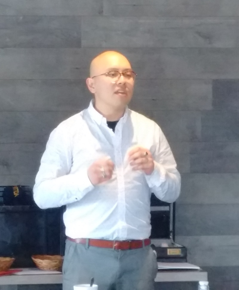 Brandon Fong speaks at a meeting of the Rotary Club of Ottawa South.
