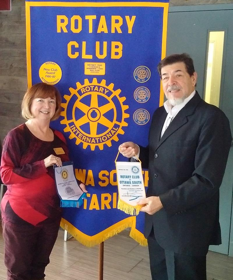 RCOS_Joan Hunter and Johnny Marquez exhcanging club pennants