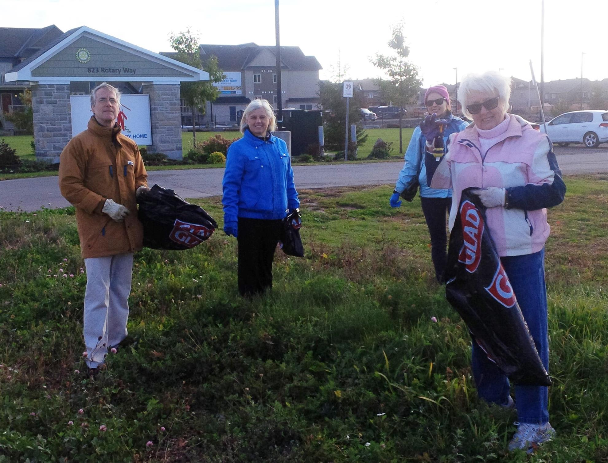 Rotary Club of Ottawa South help to clean up Bank Street.