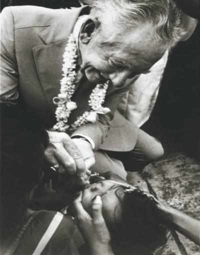 Child being given anti-polio drops in third world.