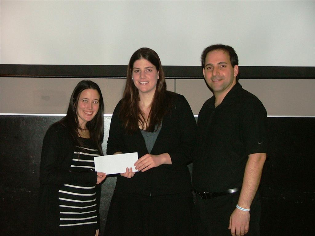 Rotaract Ottawa South presents cheque to Distress Centre of Ottawa, at KS on teh Keys restaurant
