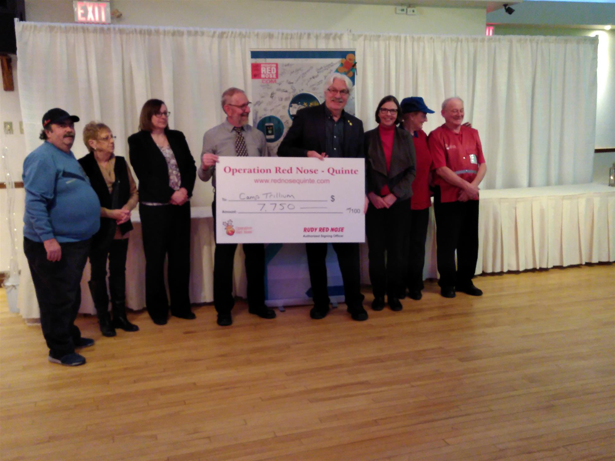 Members from Quinte Sunrise Rotary present a cheque to Camp Trillium