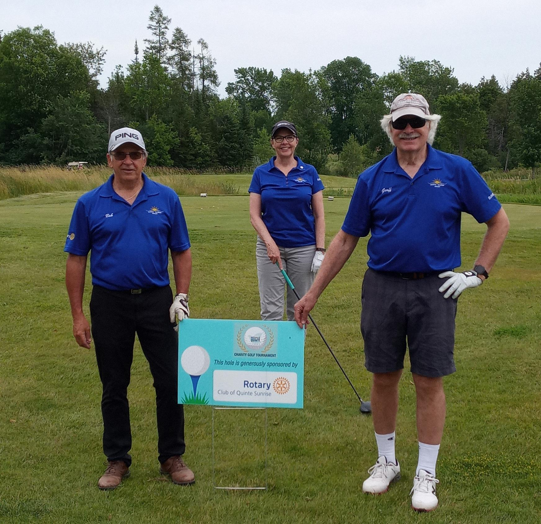 Members of the Rotary Club of Quinte Sunrise standing by the hole the club sponsored