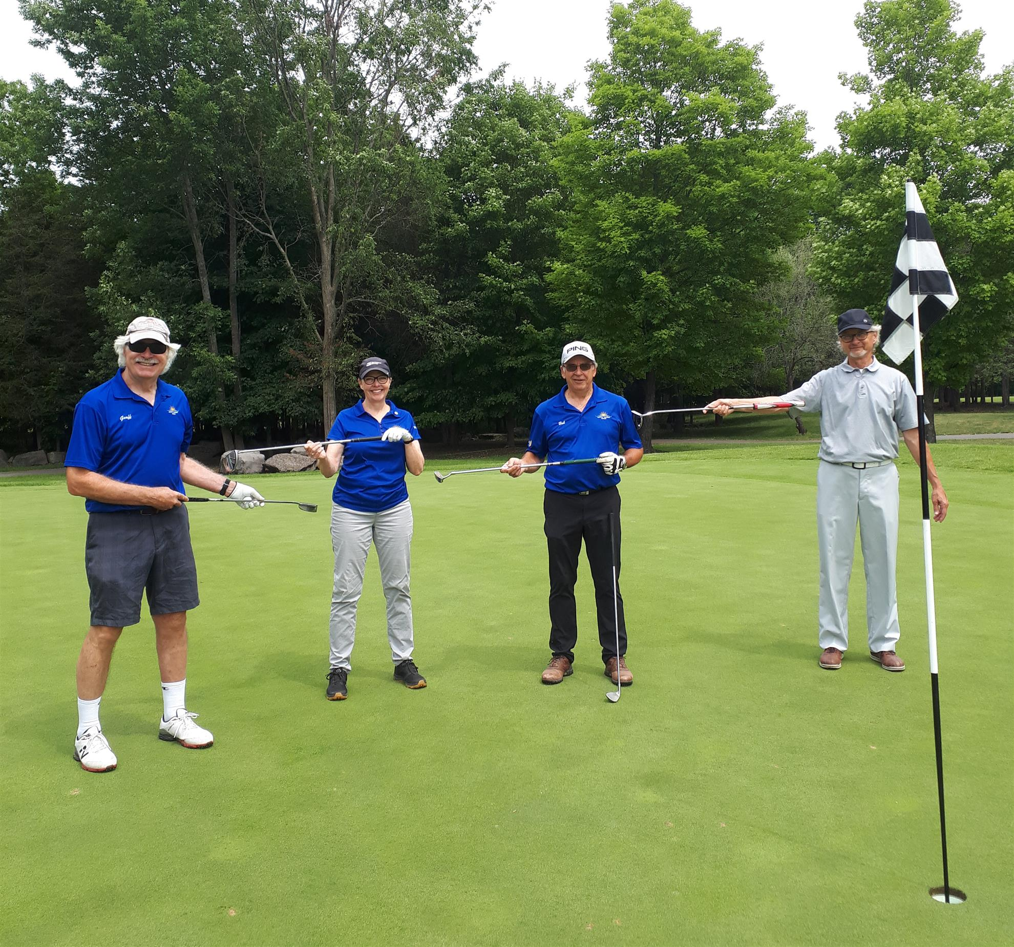 The Rotary Club of Quinte Sunrise golf team practicing golf course social distancing
