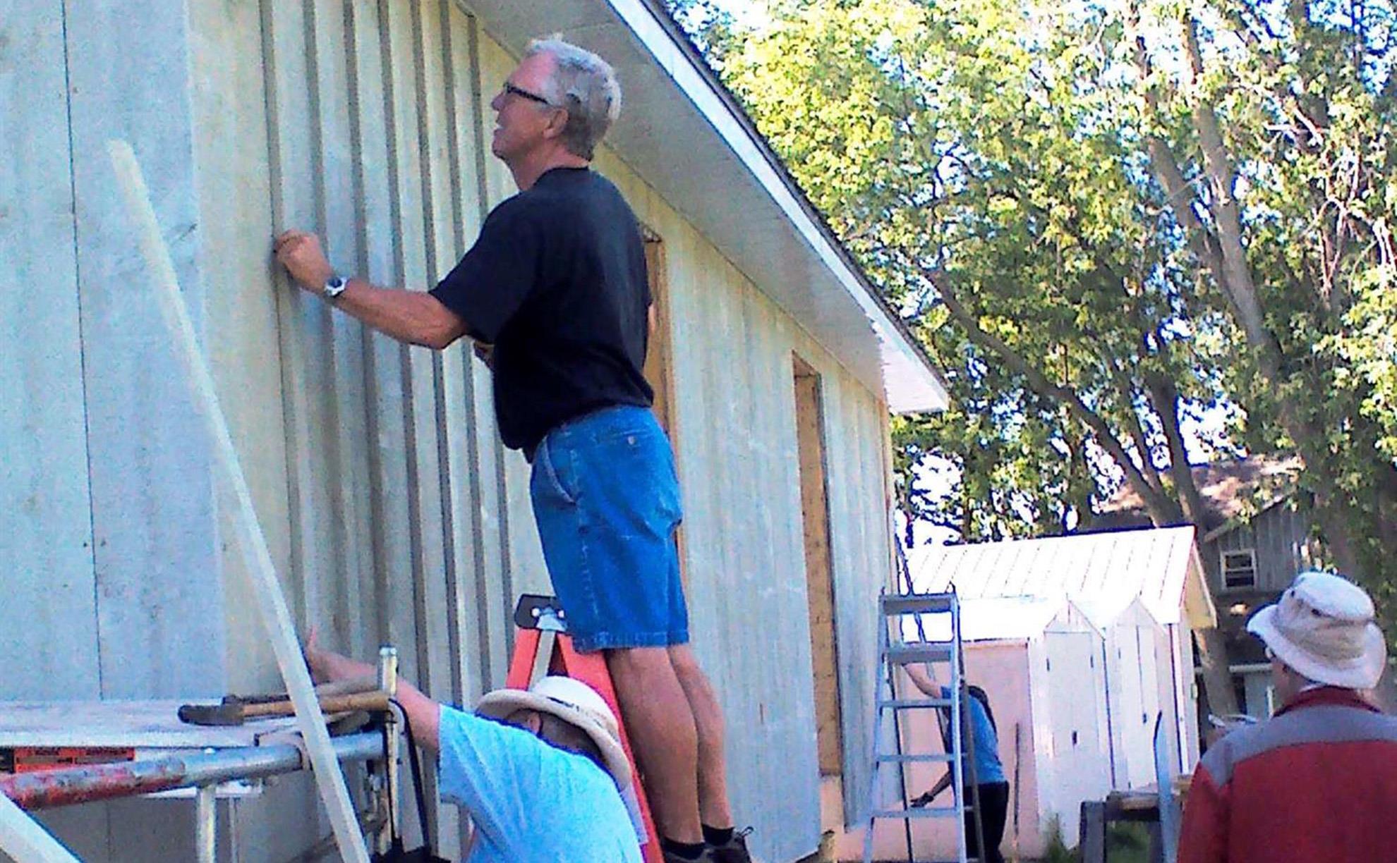 Gerry Ham repairing Camp Trillium Bunk