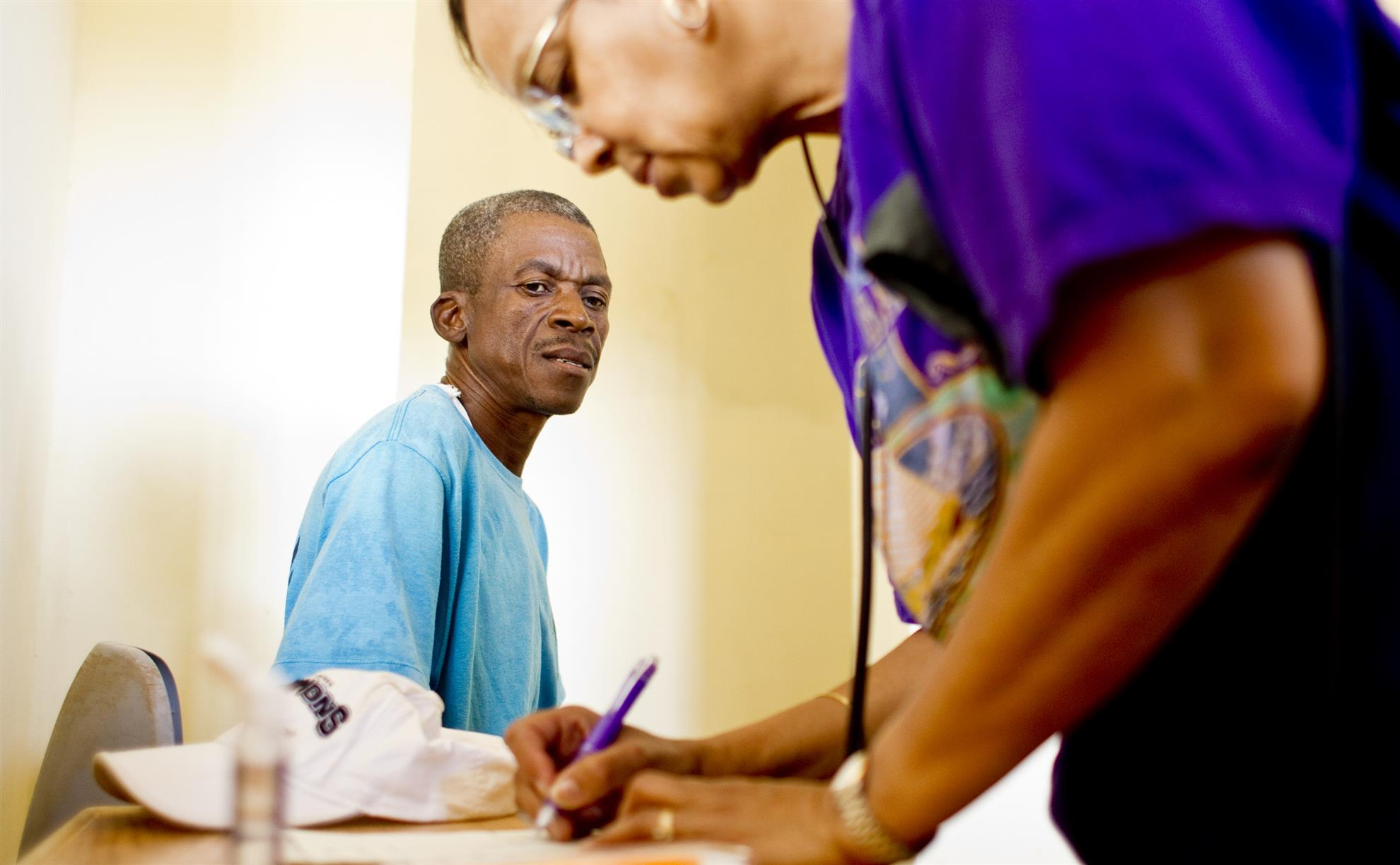 Rotarian Florence Marc-Charles triages a patient at a clinic in Nan Sema, La Gonave, Haiti © Rotary International/Alyce Henson