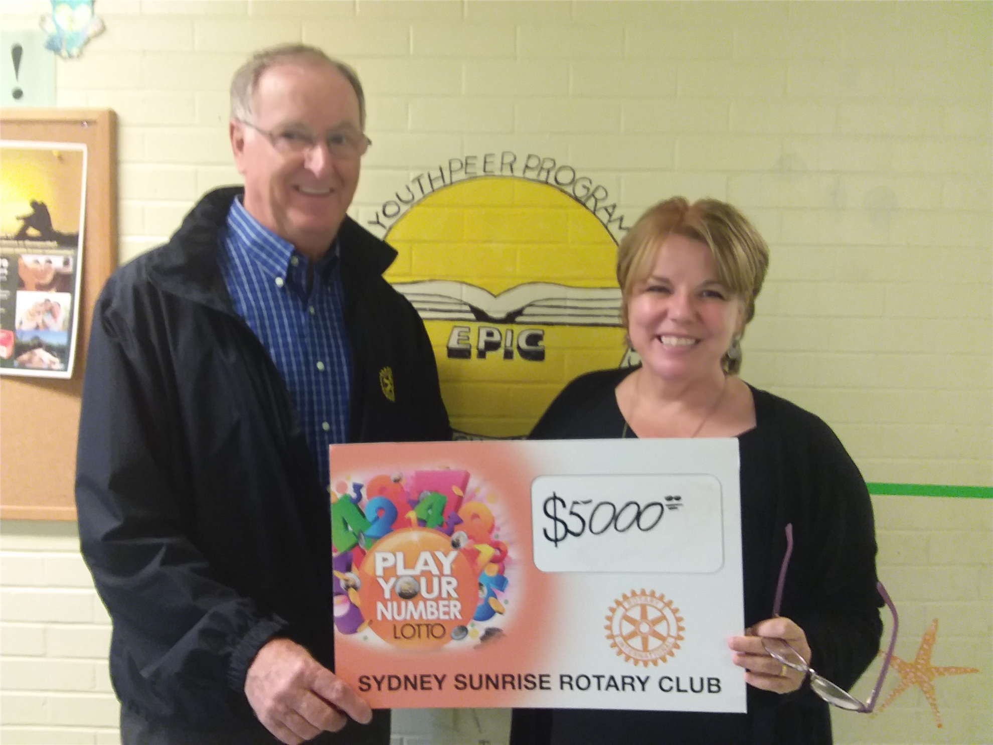 a2346a0c77498 Rotarian Ray McNeil is pictured with Delores Feltmate completing the Sydney  Sunrise Rotary Club s  5000 commitment to the Youth Peer Program.