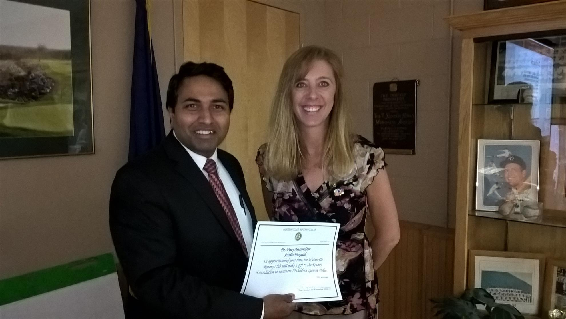 Dr. Amarendran receiving thank you from Waterville Rotary Club President Tina Chapman.
