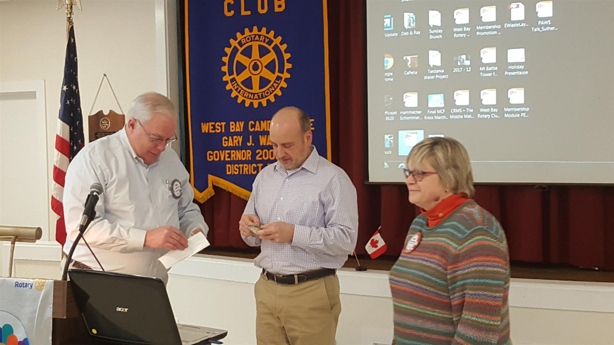 Etienne Perret received a new Paul Harris award with 3 rubies indicating  his multiple gifts of $1,000 to the Rotary Foundation.
