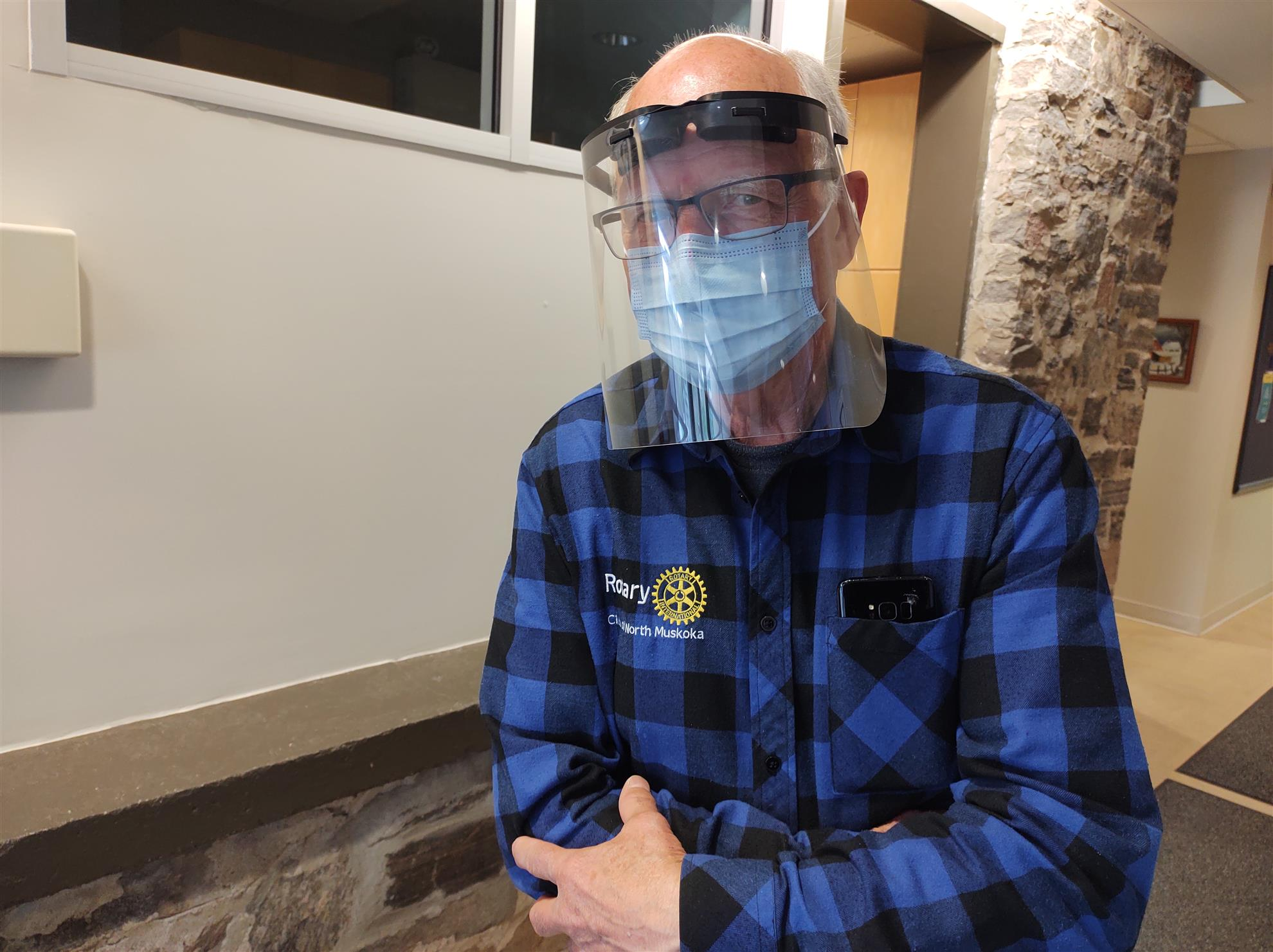 Jim wearing a face mask and face shield