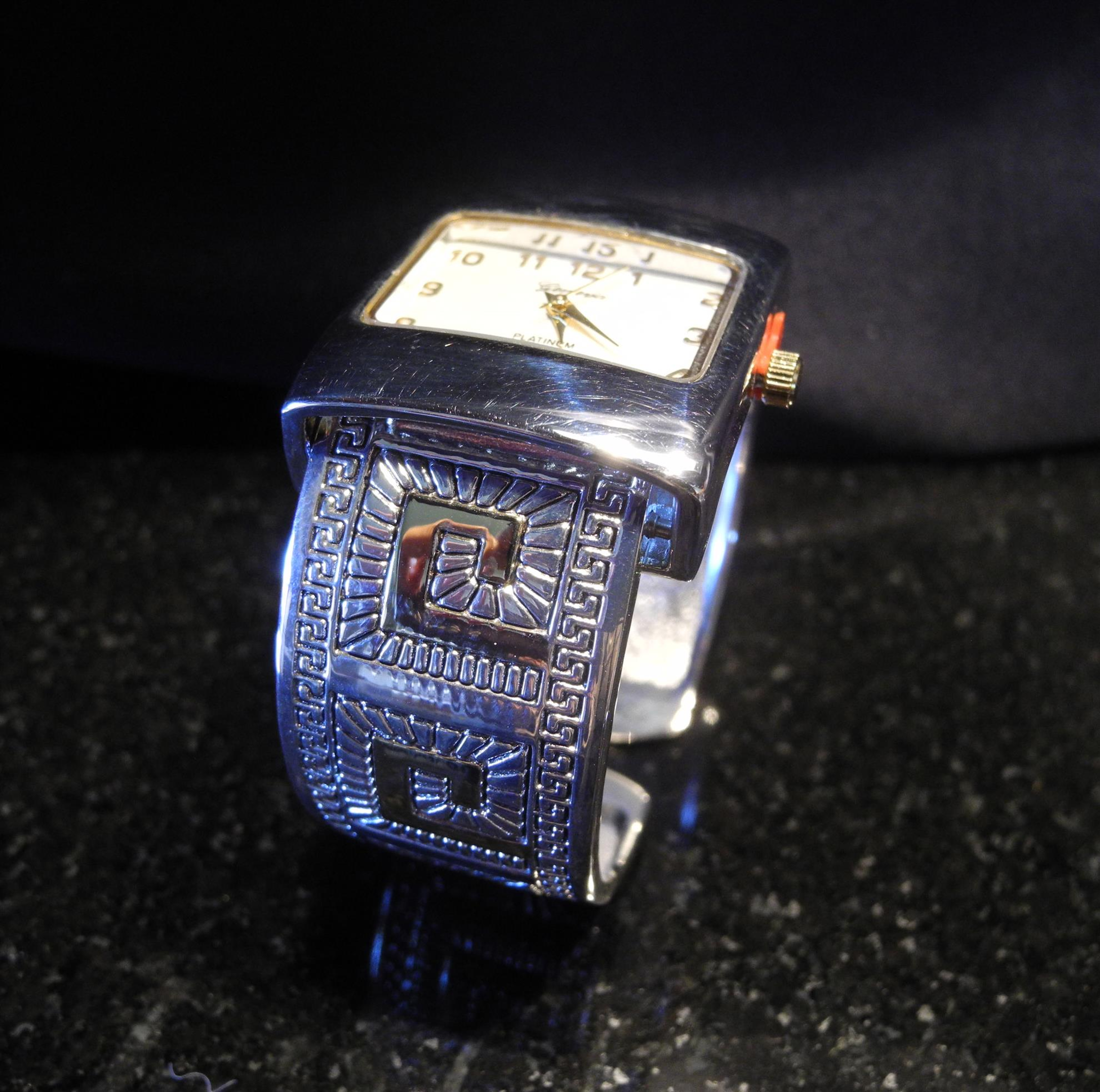 Silver and Gold toned Indian motif watch