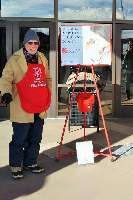 Kalispell Noon Club Rotarian Rings the Bell