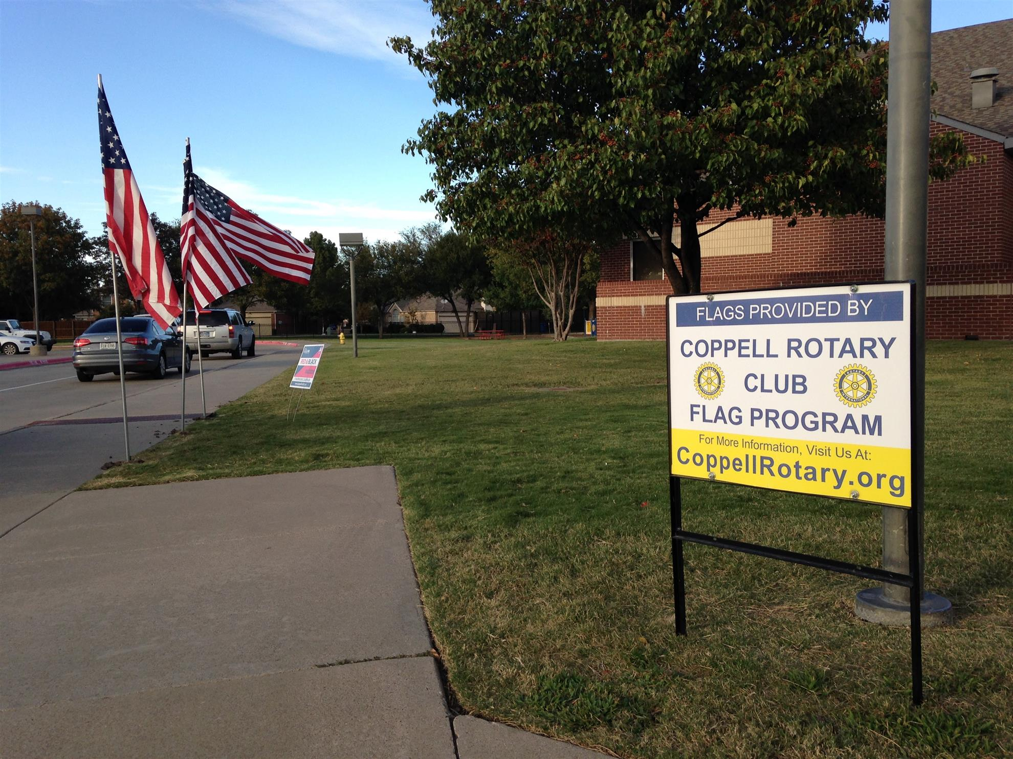 The Coppell Rotary Club provided entrance flags to W H Wilson Elementary  school in support of their Veterans Day Program Veterans Day.
