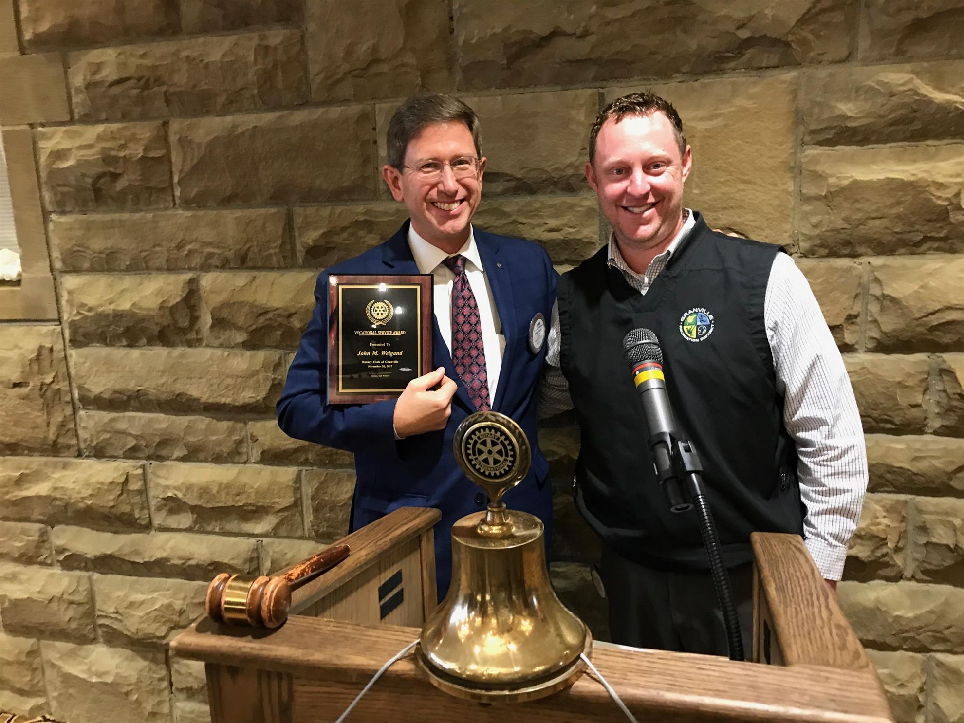 Rotary president Andy Wildman presents the Vocational Service Award to Dr. John Weigand