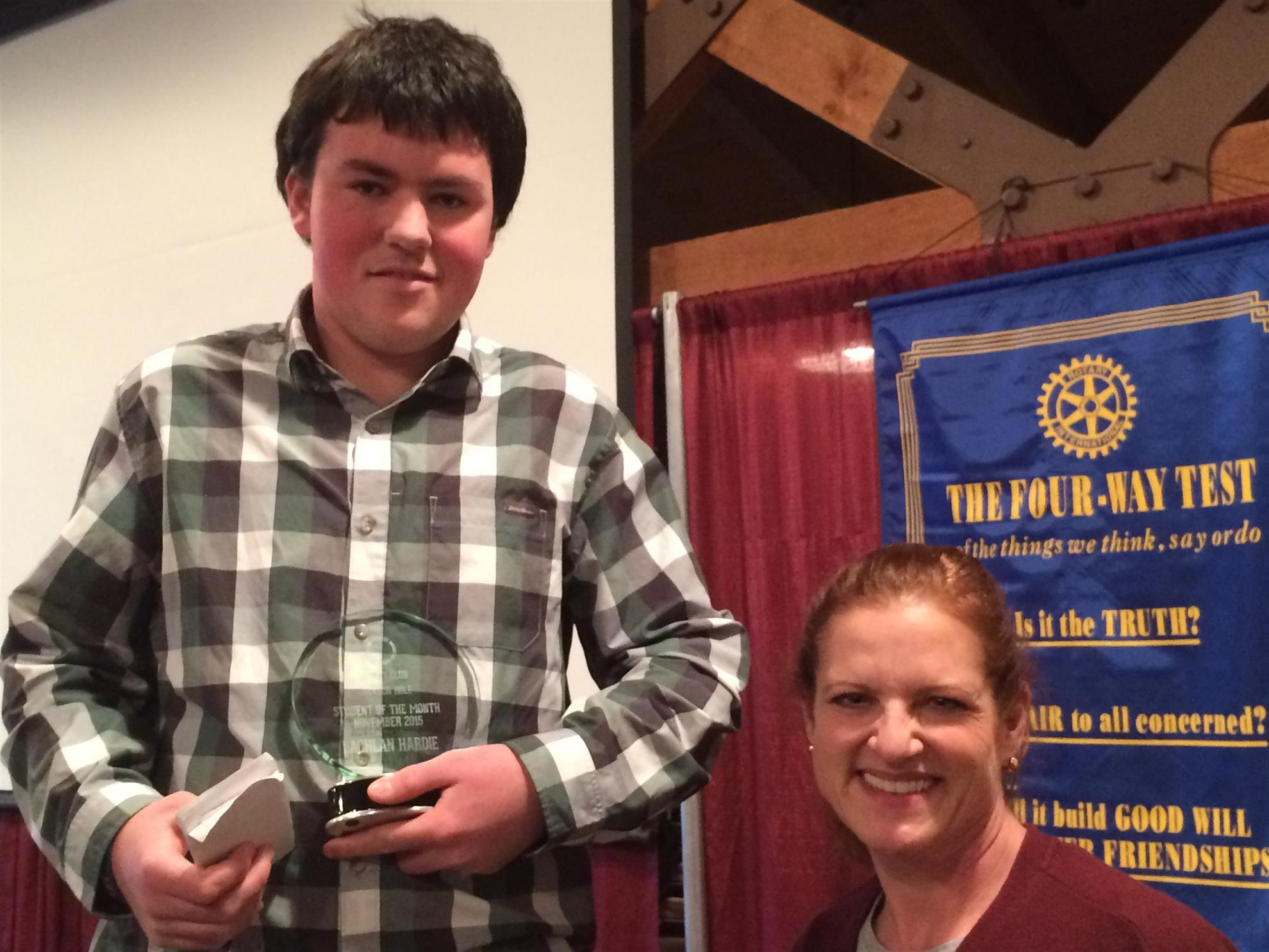 Summit High School Student of the Month Lachlan Hardie receives his award from club President Clare Payne-Symmons