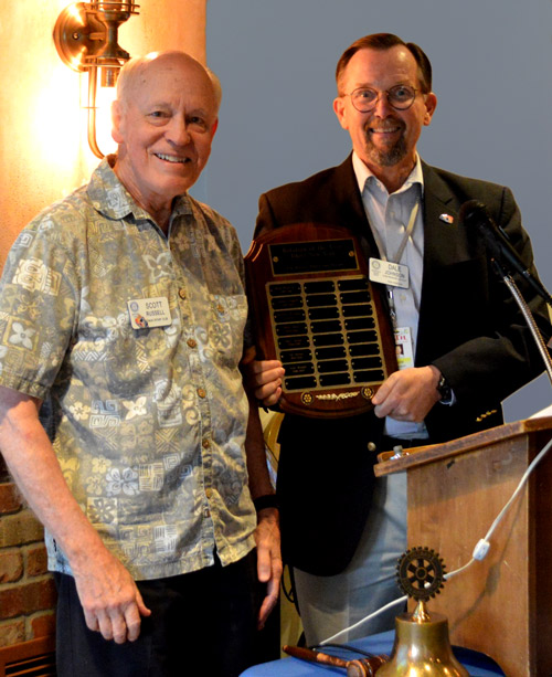 Scott Russell receives Rotarian of the Year from Dale Johnson
