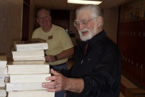Bill Hawley and Gale Smith packing books at Ithaca High School