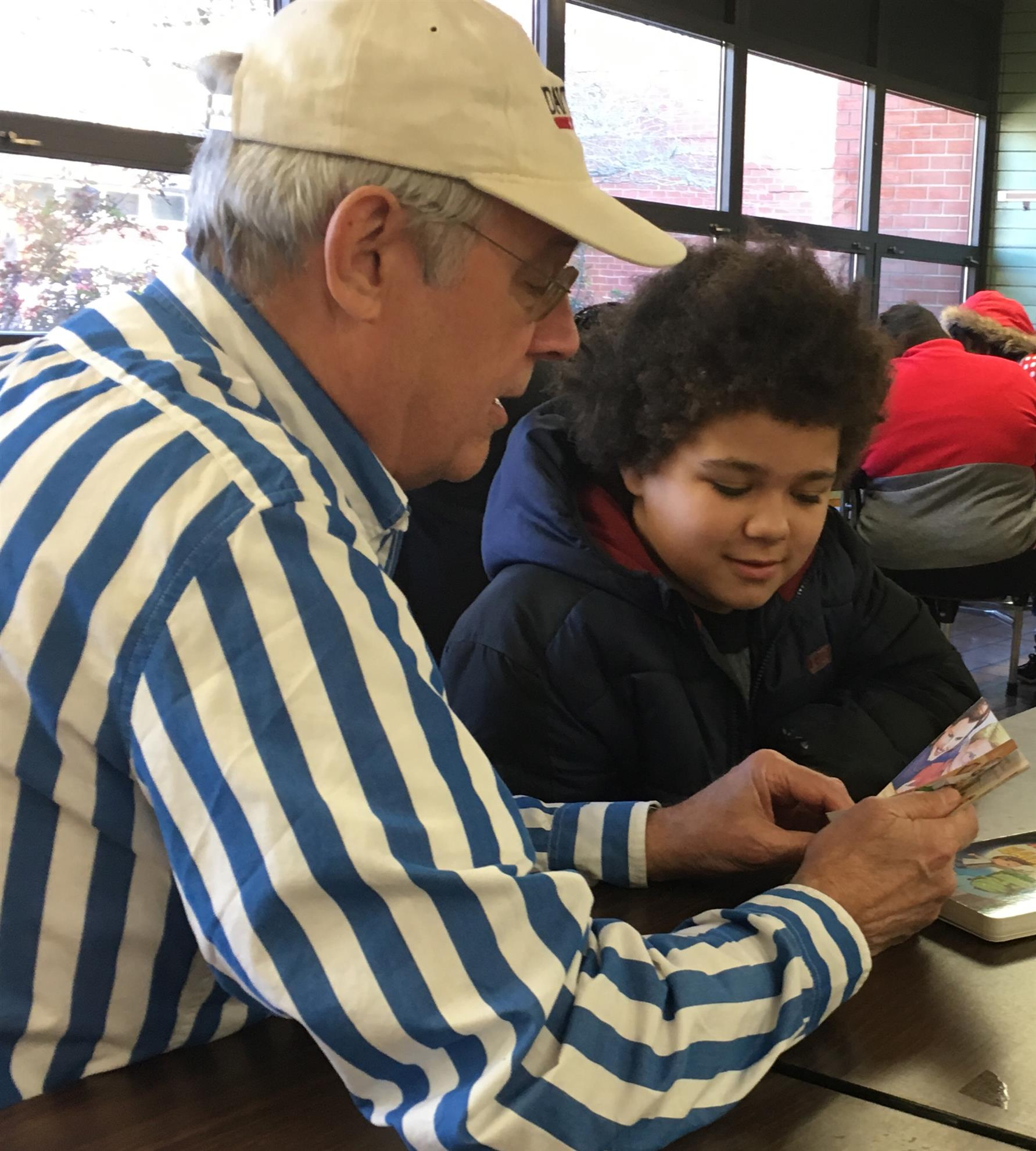 e5faf32c0bb Chip Vogan was among nearly a dozen Rotarian volunteers reading one-on-one  with students at P.B. Young Elementary School recently as part of Horizons  ...