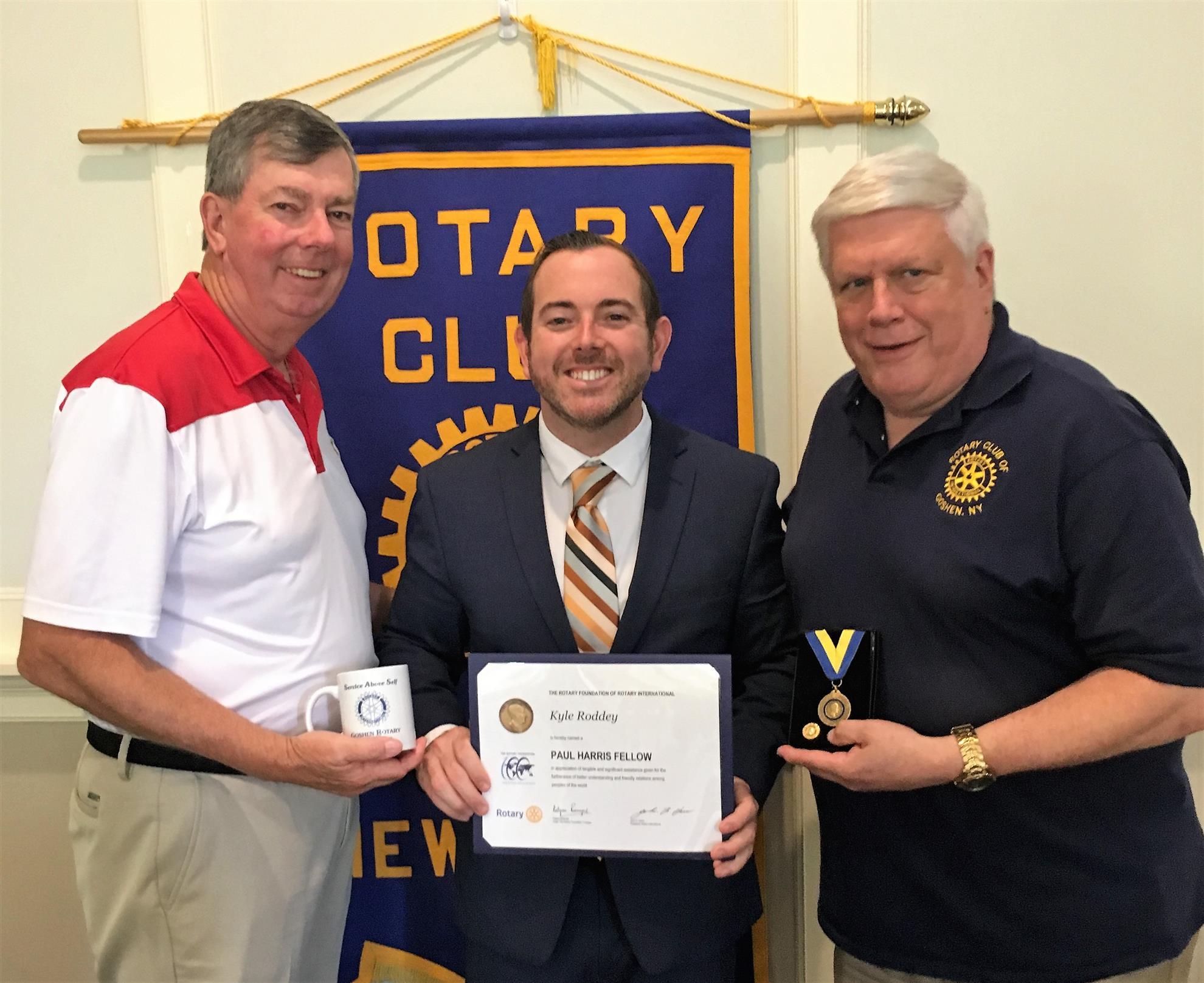 Kyle Roddey receiving a Paul Harris Fellowship Award