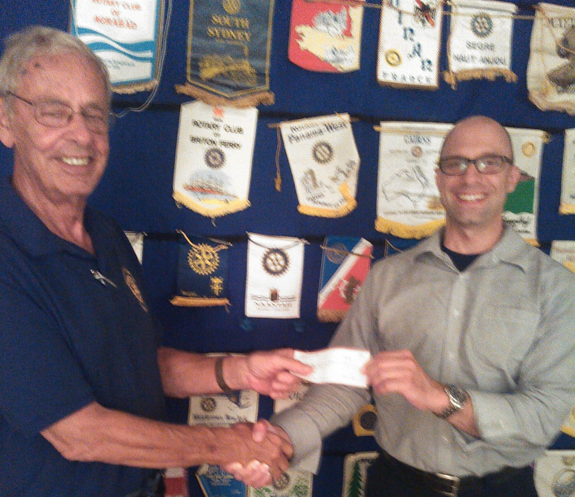 8/13/18 - Ken presents Mark Thabet a $300 check for the Child Care Council of Orange County