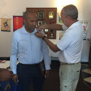 Sandy Sawyer (L) being pinned by Rotarian Richard Bates
