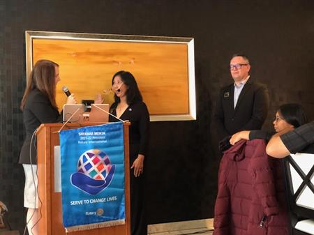District Governor Danielle Lallement inducts President Mary Liu as Past President JT Forbus looks on